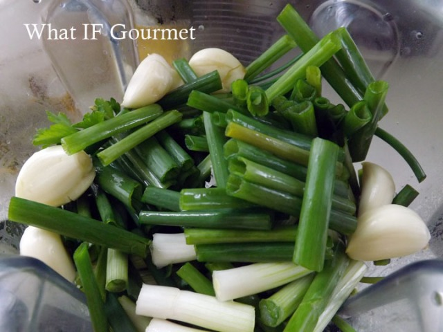 Scallions, garlic, cilantro, Italian flat-leaf parsley, and thyme waiting to be pureed into green seasoning.