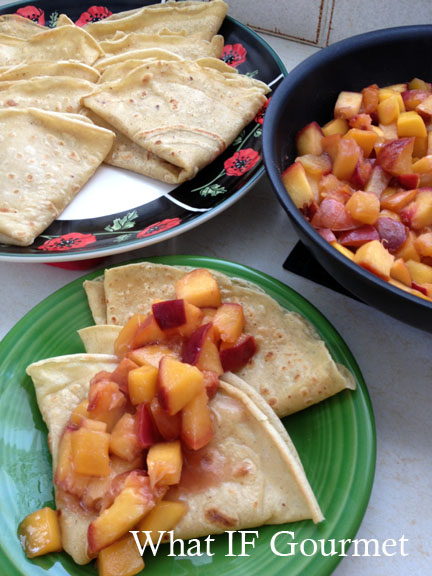 Cinnamon vanilla crepes with mango-peach compote.