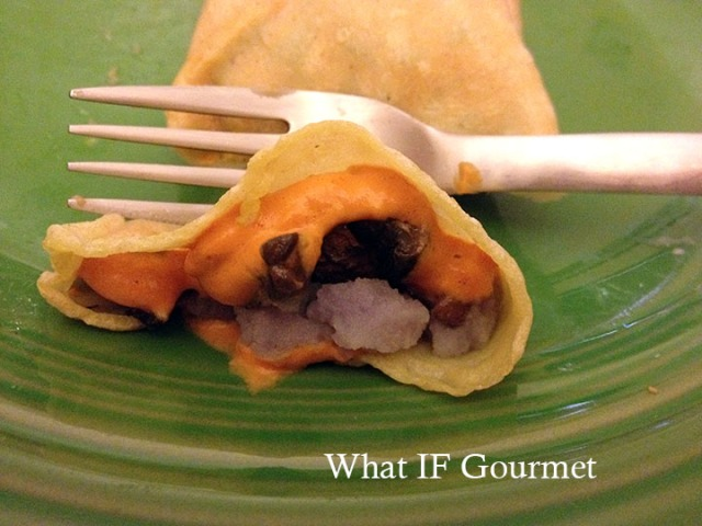 Gluten-free crepes stuffed with coarsely mashed purple potatoes, sauteed crimini mushrooms, and curried carrot dip.